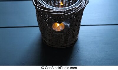 Candle in a wicker wooden candlestick