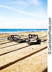 Flipflops - Black flipflops on the dock by the beach