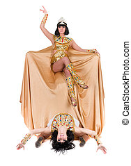 Dancing pharaoh women wearing a egyptian costume Isolated on...