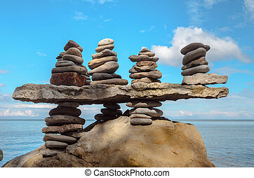 Stacks of stones - Balance a few stack of pebbles on rocky...
