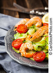Prawns, zuchini noodles and tomato - delicious healthy food