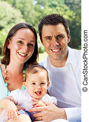 portrait of young family - portrait of a happy young family...