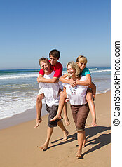 fun family piggyback - a fun family of four with parents...