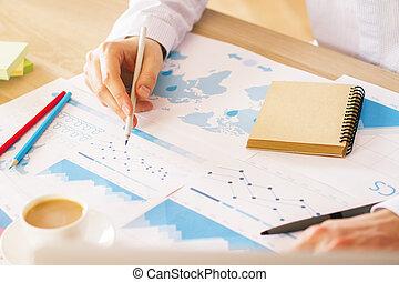 Man analyzing charts
