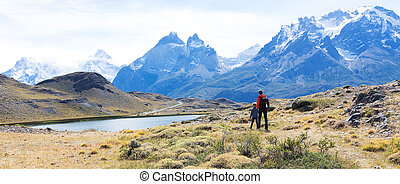 family on patagonia - panorama of family hiking in beautiful...