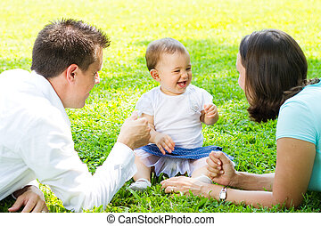 happy family outdoors - a european happy family playing...