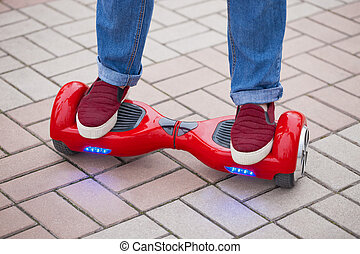 electric mini segway hovev board - Feet of a girl riding on...