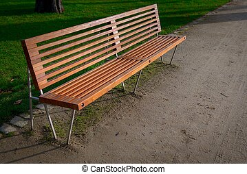 Bench in the park - Wooden bench in the park closeup photo