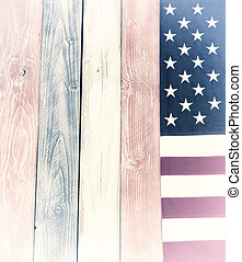 Border of vintage USA flag on faded painted wooden boards in national colors