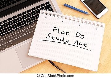 Plan Do Study Act - handwritten text in a notebook on a desk...