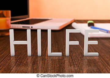 Hilfe - german word for help - letters on wooden desk with...