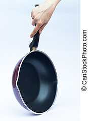 Hand with non stick frying pan on white background, stock...