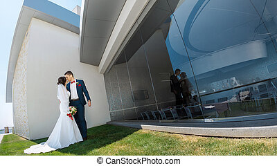 Young wedding couple standing outdoors - Young wedding...