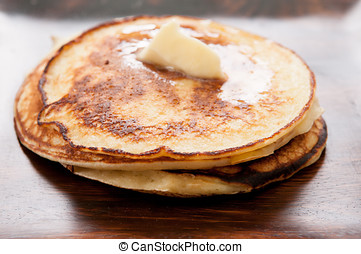 pancakes with melted butter - a stack of hamemade pancakes...