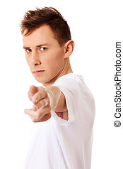 Young angry man doing a gun gesture
