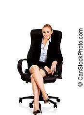 Young smile business woman sitting on a chair in office.