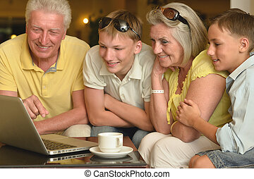 boys with grandparents and laptop - Portrait of a happy boys...