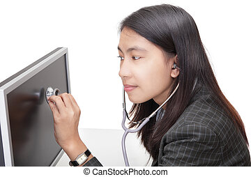 Businesswoman examining PC screen w stethoscope - Young...