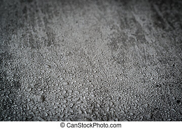 Wet concrete background with selective focus
