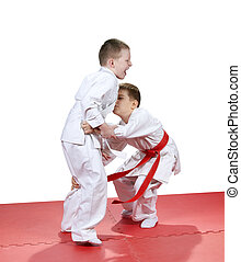 Children are trained judo sparring - Children in...