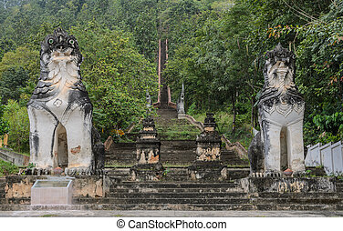 Guarded stone Shan lions - Burmese sculpted lions statue at...