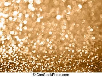 golden glitter light bokeh background; defocused