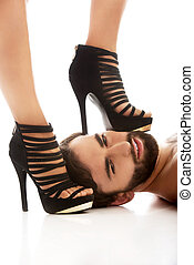 Woman's foot on man's face. - Sexy woman's foot in high heel...