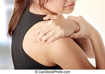 Back pain concept - Young woman with pain in her back