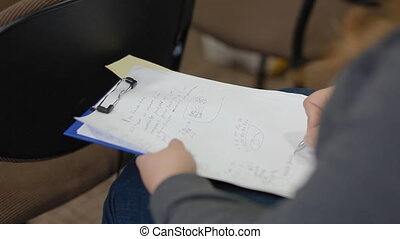 Woman take notes in a notebook Closeup