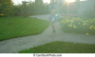 Little Boy Running in the Backyard - Little boy is running...