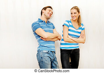Smiling happy loving couple standing in empty room