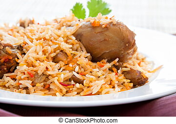 Chicken Biryani - Plate of delicious chicken biryani -...