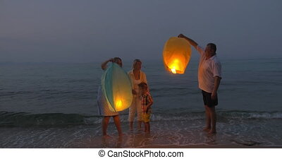 Happy Family Releasing Sky Lantern - Happy family is...