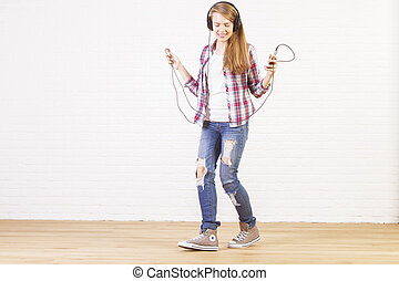 Female dancing to music - Young caucasian female happily...