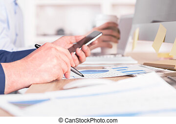 Businessman using phone - Sideview of businessman using...