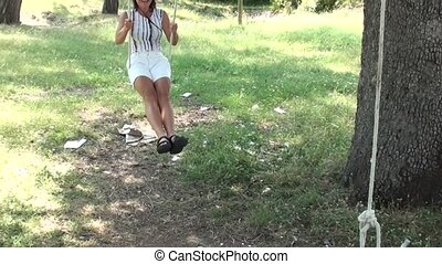 Young woman on seesaw 2