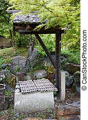 ancient stone well in japanese gard - Japanese zen garden...