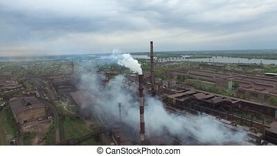 Old factory smoke stack - Old factory smoke stack billowing...