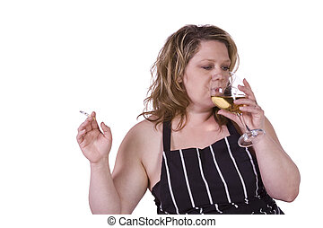 Beautiful Woman Drinking Wine in the Kitchen