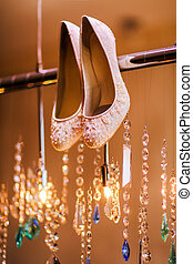 Luxury bridal shoes with beads. Wedding concept