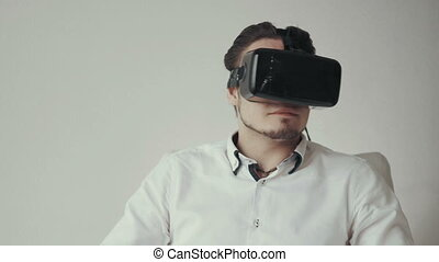 Man Using Virtual Reality Glasses. Special Headset. Isolated...