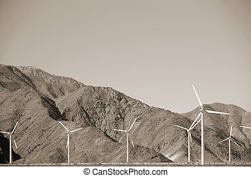 Windmills in front of harsh mountain ridges - Wind turbines...