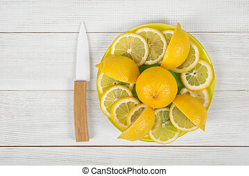 Lemon peaces laid out around the whole lemon on a board with...
