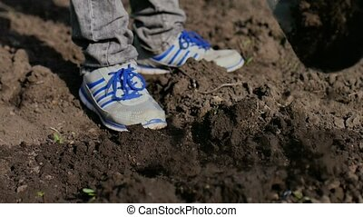 man farmer digs ground old dirty shovel on dry ground...