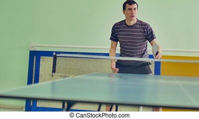 man playing sport table tennis slow motion video backhand -...