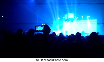 phone display at the concert - Here is footage of people...