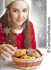 Beautiful Christmas girl wants to eat cookies