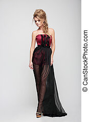 Woman posing in elegant dress.