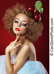 Woman with red cherries.