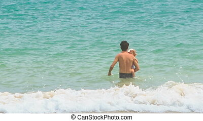 Backside Father Carries Little Daughter Azure Sea - backside...